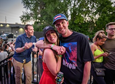 """A couple embraces as they line up to get some of Chromeo's """"Bonified Loving""""!"""