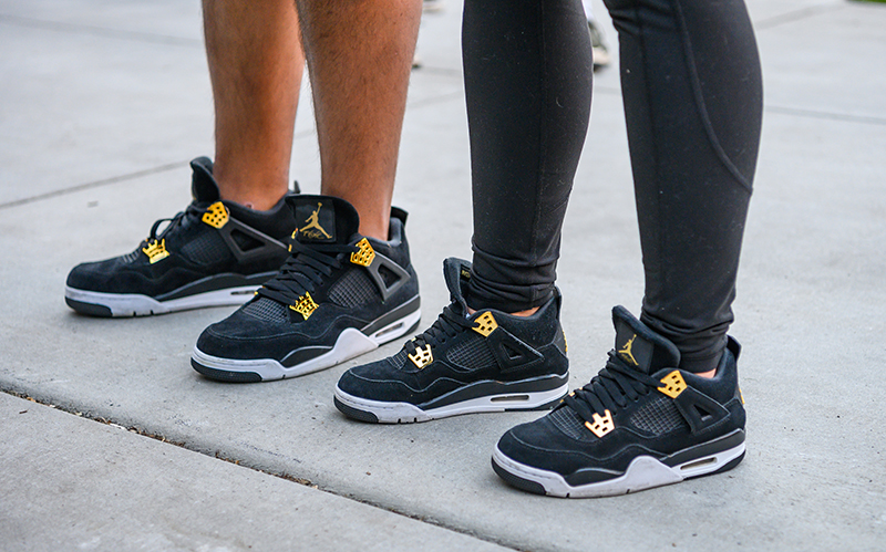 An SLC couple expresses their love for each other while rocking their limited-release Jordan 4 Retro Royalty sneakers.