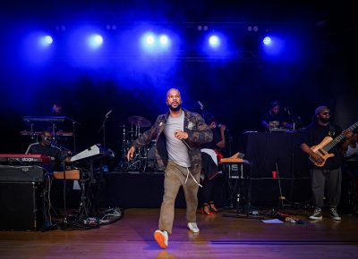 Common comin' at ya as his live band performs in the background.
