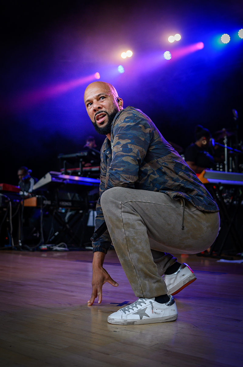 Common crouches in his Converses as he converses aloud to the crowd.