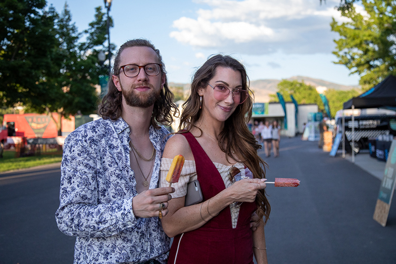 (L-R) Jake Chamberlain and Kine Kino grab some di Fruitta pops—strawberry mango for him and watermelon mint for her. He also performed at Craft Lake City's SLUG Stage in Jake and the Heist.