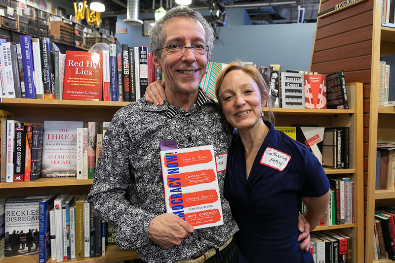(L–R) Tony and Catherine Weller share their love for Amy Goodman while browsing their favorite section at Weller Book Works—the ISMs.