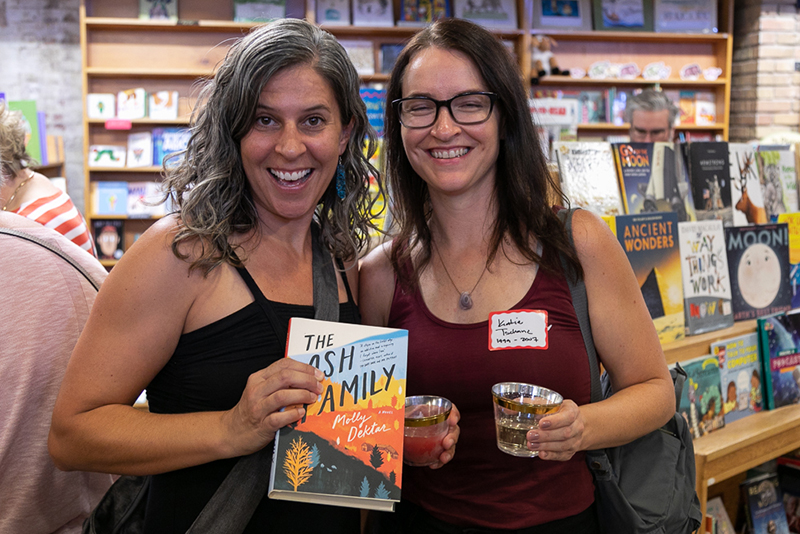 "(L–R) Susan Fleck and Katie Tschanz talk about The Ash Family. ""Lila Weller told me to read this, and I haven't read a better book in years. It's about young women and cult mentalities,"" Fleck said. ""Sold,"" Tschanz said."