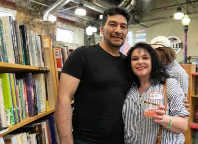 (L–R) Juan Pablo and Jewel Story enjoyed the 90th anniversary celebration, but they also returned for the after hours after party for past and present employees. Story worked at Sam Weller Books from 1995–2001.