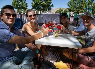 (L-R) Jose Cuaresma, Emily Christopher, Maddy Christopher and Scott Moffitt took advantage of the Maker's Mark wax dipping station on the patio at the Harmons VIP Lounge.