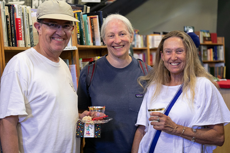 (L–R) Rep. Joel Briscoe, D-Salt Lake, Jane Colby and Monica Hilding stand between the economics and health aisles. Briscoe is looking for a used copy of Bruce Bartlett's The Benefit and The Burden: Tax Reform-Why We Need It and What It Will Take.