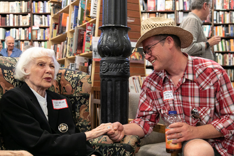 (L–R) Lila Weller shares a story with Mattson, who worked at the bookstore from 1996-2007. Mattson remembers sitting near Tony Weller's desk as he and Sherry Zollinger wrote the bookstore's newsletter. He's particularly fond of an issue that included book reviews written by 13-year-old Lila Ann Weller and her teenage friend.