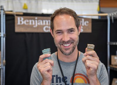 In the Crafters Building, Benjamin Gawle knew that he needed to fire up a bigger batch of tiny robots for Craft Lake City this year—he sold all he had at the 2018 DIY Festival.