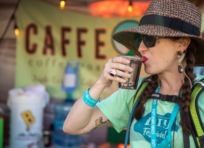 Craft Lake City Executive President Angela Brown sips Caffe Ibis's iced coffee as the 2019 DIY Festival winds down Sunday, August 11. This 11th annual event marked its second decade with a new home at the State Fairpark, and Brown couldn't be happier.