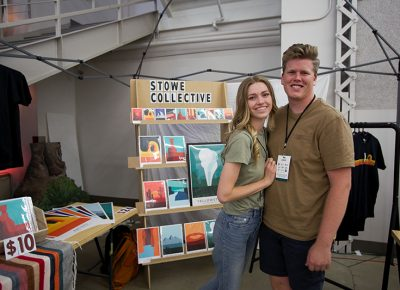 Stowe Collective smiles at their awesome booth.