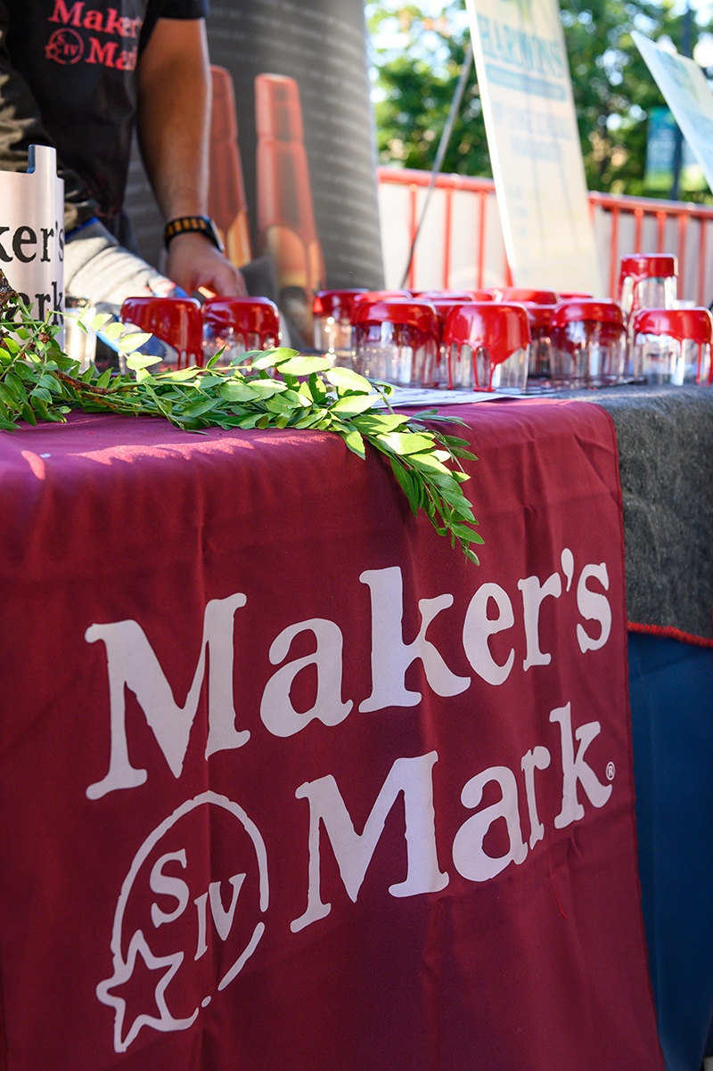 Makers Mark hand-dipping cups in the VIP section.