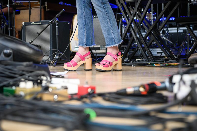 The Hollering Pines kick off their sound check donning stylish high heels