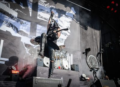Pumped and primed to rock, Behemoth guitarist jumps on a cabinet at Thursday night's Knotfest Roadshow.