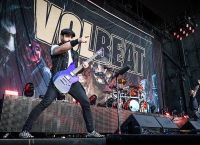 Volbeat guitarist Rob Caggiano points out over the crowd as he slays his six string.
