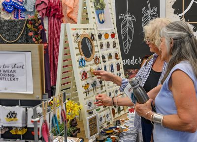 Shoppers admire the work of a talented artisan.