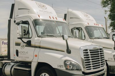 A team of Nicholas and Company trucks ready to hit the streets.