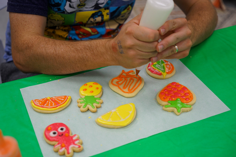 A participant in the Cookie Decoration Workshop creating some wonderful cookies.