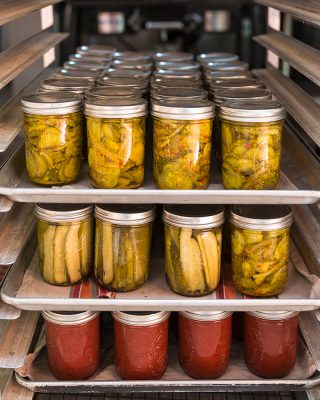 House-made bread & butter pickles, dilly pickles, and crabapple jam. Canning is crucial to our farm-to-table restaurant, as it helps us preserve the harvest for the colder months when the farm is less productive.