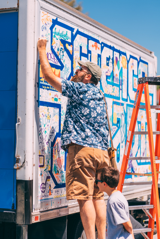 DIY Fest patrons show their love of graffiti and science by tagging a science van.