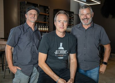 (L–R) Erik Ostling, Chris Barlow and Matt Aller brought to fruition their vision of offering a distillery and bar to the Salt Lake area with Beehive Distilling.