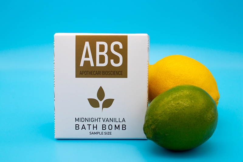 ABS' CBD bath bomb, pictured with a lemon and a lime.