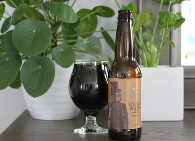 """Young Bruin pours with the color of deep amber and dark-garnet undertones."""