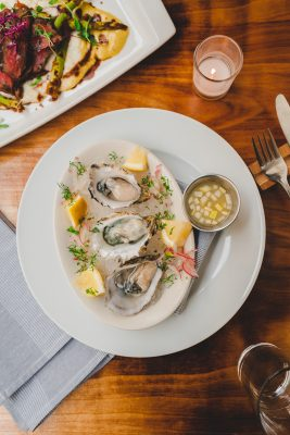 Add a round of oysters with green-apple Leche De Tigre as the bulk of your meal.