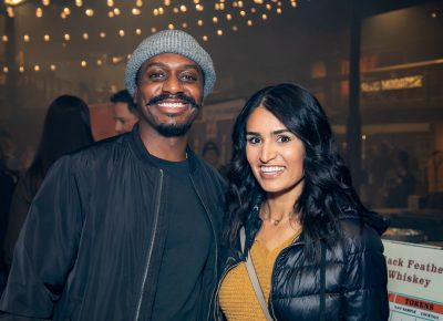 (L–R) Eric Johnson and Nakisa Mirrasi attend one of SLUG Magazine's brew-themed events for the first time. He started with New World Distillery's Oomaw Gin Hanky Panky and she started with peach whiskey.