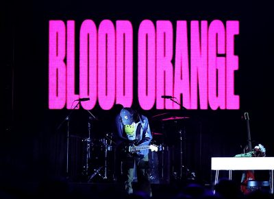 Blood Orange takes up a guitar and strums in the dark.