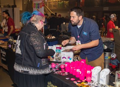 (L–R) Darcy Murphy chats with Mike Aguilar about how important it is to support Planned Parenthood. Boo!stillery's pink mugs included a $5 donation to Planned Parenthood.