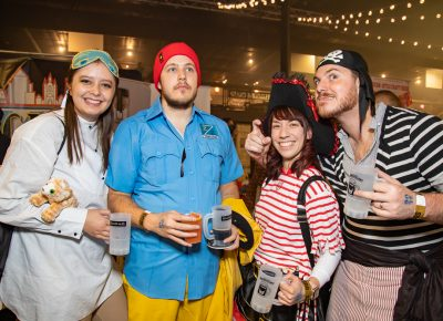 "(L–R) Whitney Van Alfen, Jared Stanger, Melinda Segina and Caleb Segina are impressed with the drinking scene in Utah. The Seginas were visiting from San Diego: ""From one craft beer capitol to another craft beer place,"" Caleb said."