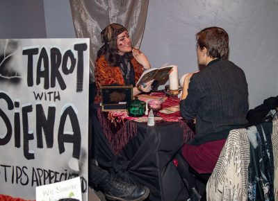 "(L–R) Tarot diviner Siena reads Julia Maier's cards. The take-away? ""Trust yourself,"" Maier said."