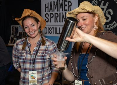 (L–R) Lulu Podratz and Vita Bernier work the Hammersmith booth as Bernier pours a Casper cocktail—their spooky take on a Vesper martini.