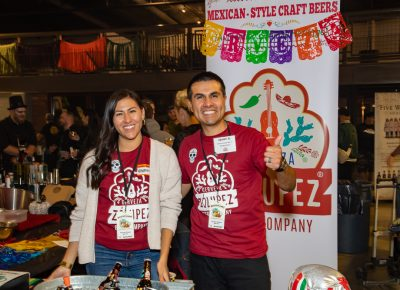 (L–R) Andrea and Javier Chávez Jr. promote Zólupez Cervesa at Boo!stillery.