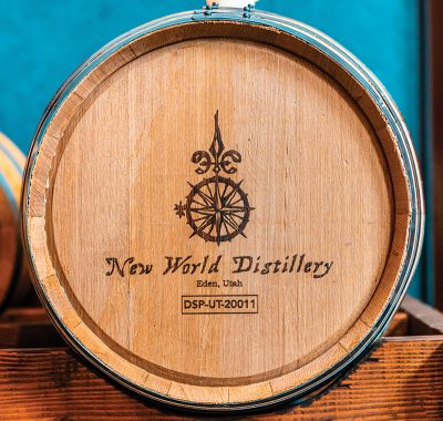 New World Distillery's logo printed on one of their barrels.