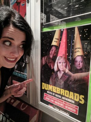 Rothenberg points gleefully at the Dumbbroads poster.