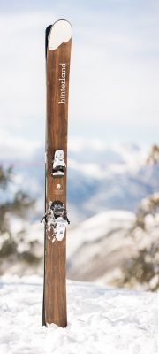 A pair of Hinterland's wooden skis posted in a deep pit of powder.