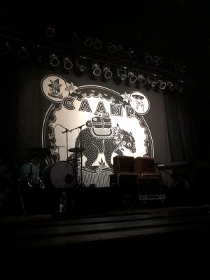 Stage backdrop displaying CAAMP's new album cover.