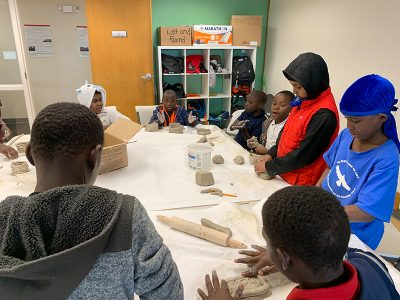 MICA organizes after-school programs where kids work on crafts with professional artists.