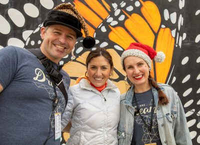 (L–R) John Ford, Ana Valdemoros, and Angela Brown meet outside The Monarch, the Ogden location for Craft Lake City's first Holiday Market.