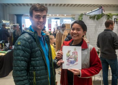 (L–R) Bren and Katherine picked up a print for Bren's brother. It's a silly cat print that will suit his brother's sense of style and humor.