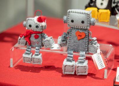 GINNYPENNY's felt robots are sold as kits or assembled robots. Craft Lake City's merch booth sells a GINNYPENNY robot kit as a fundraiser.