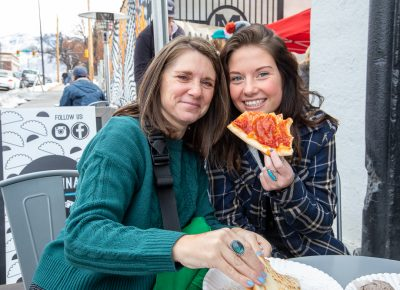 (L–R) Karisa and Mabry Williams grabbed a quick bite from Lucky Slice before they hit the booths at Craft Lake City's Holiday Market.