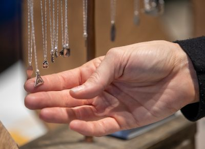 The Bearded Jeweler makes camping-themed charms on necklaces. The outdoor themes and reasonable prices hit the Holiday Market's sweet spot.