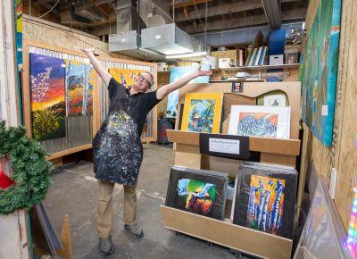 Monarch artist-in-residence Christopher Lubeck gleefully welcomes Holiday Market patrons into his studio. Many of The Monarch's resident artists opened their doors to Craft Lake patrons throughout the day.