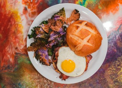 Roots Café's Utah Burger is topped with a succulent fried egg and goes great with baked kale.