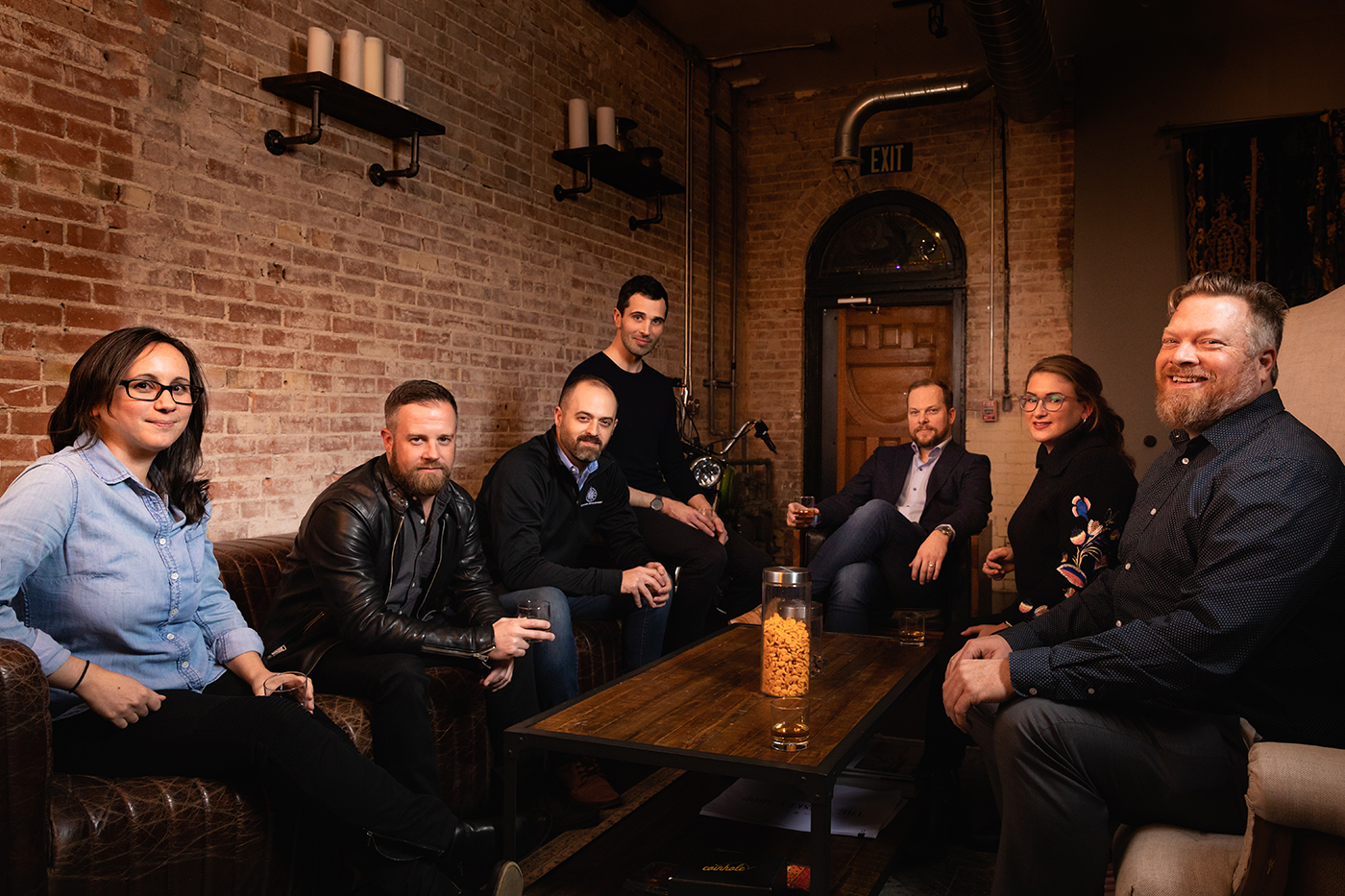 (L–R) Pictured at Black Feather Whiskey, Roberta Reichgelt, Peter Makowski, Ben Kolendar, Jacob Maxwell, Andrew Wittenberg, Simone Butler and Will Wright comprise the Business Development Division of SLC's Department of Economic Development.