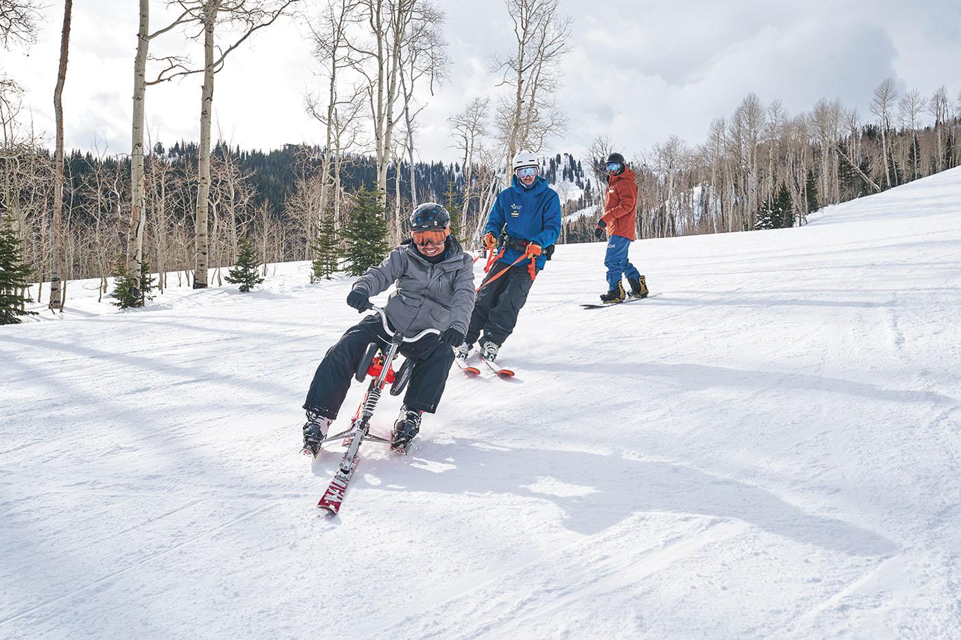 (L–R) Serei Panh, Ski, Snowboard Program Manager Brian Castillo and Snowboard Head Coach/Program Equipment Supervisor Colton Bradley enjoy riding at Park City Mountain as a part of the National Ability Center's adaptive-recreation program.