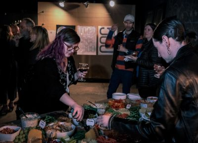 Lightscatter Press hosted a launch party on February 28, 2020, which included beer, wine and a table chock full o' charcuterie.