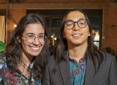(L–R) Literature and Creative Writing doctoral students Jaqueline Balderrama and Samyek Shertok read poems and received a warm reception from Lightscatter's supporters and friends.